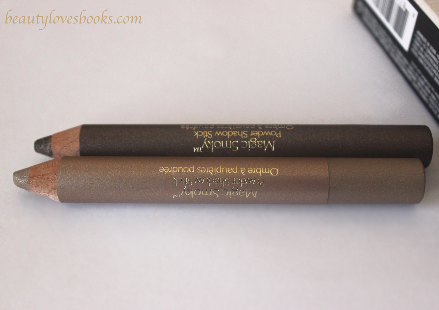 Estée Lauder Magic Smoky Powder Shadow sticks in 04 Slow Burn/ 06 Scorched gold