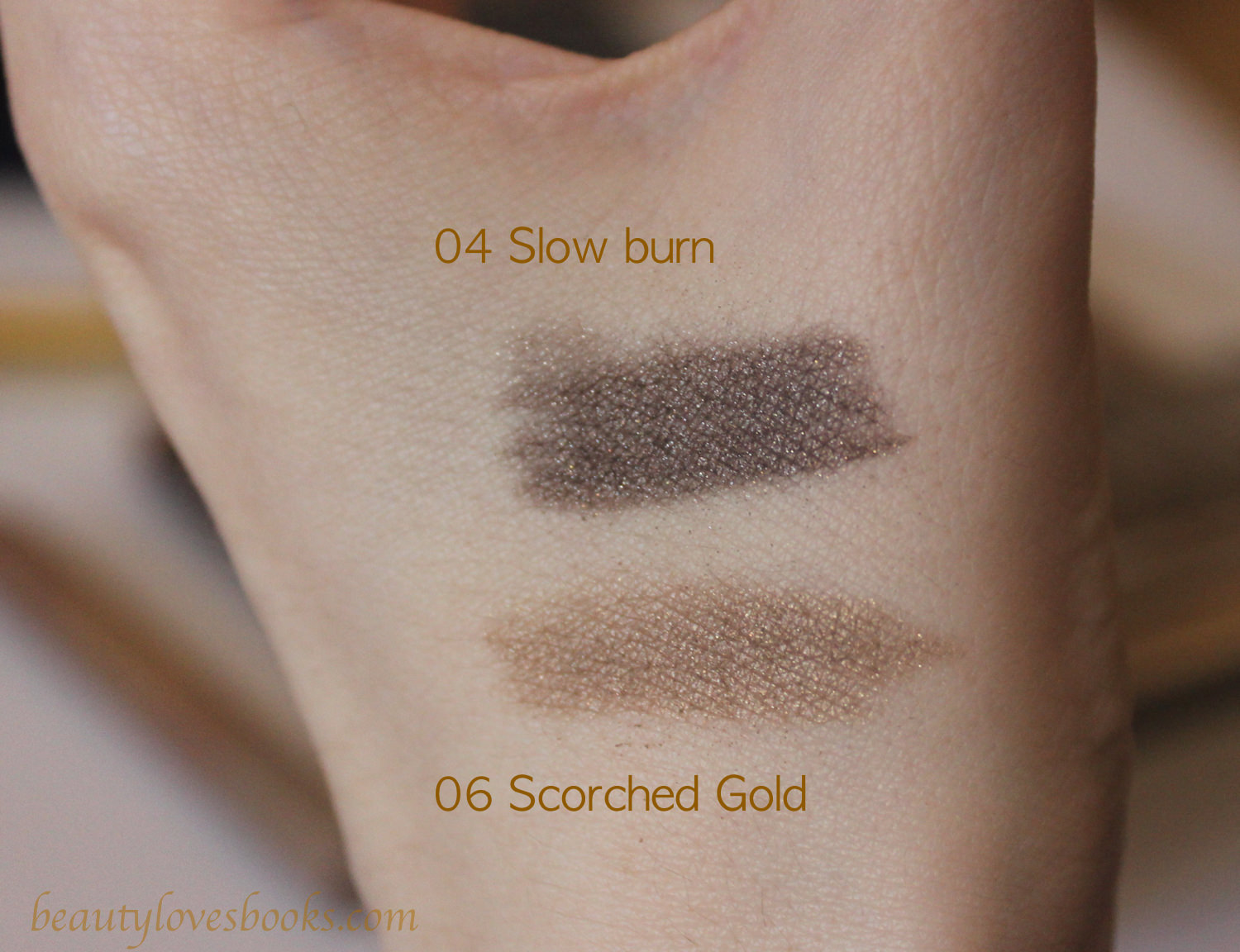 Estée Lauder Magic Smoky Powder Shadow sticks in 04 Slow Burn/ 06 Scorched gold swatches